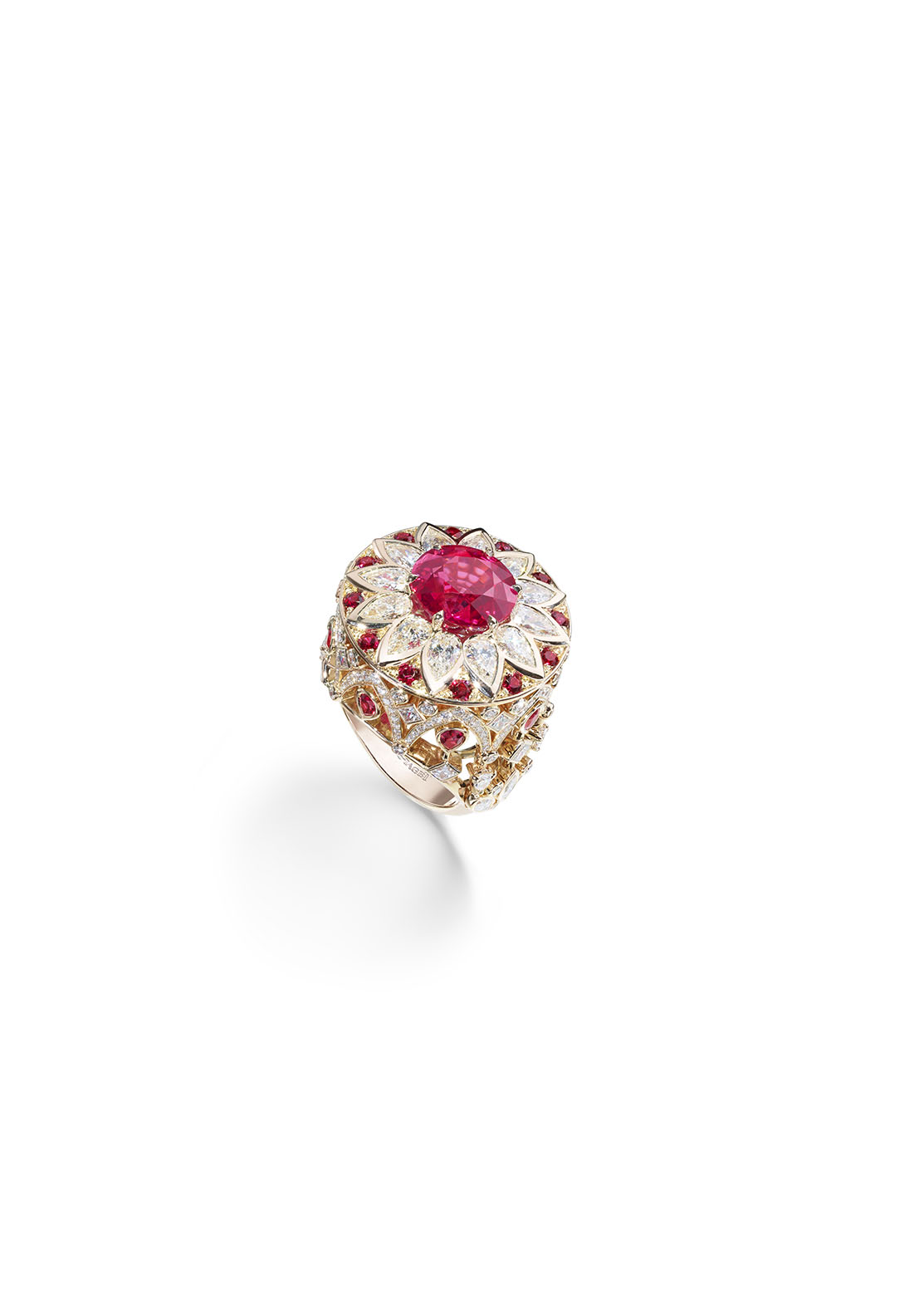 Piaget's High Jewelry Collection: Palazzo Ring. 18K pink gold set with a round-cut red spinel, 12 round-cut red spinels, eight pear-shaped red spinels, 16 pear-shaped diamonds, 14 princess-cut diamonds, six marquise-cut diamonds and 150 brilliant cut diamonds.