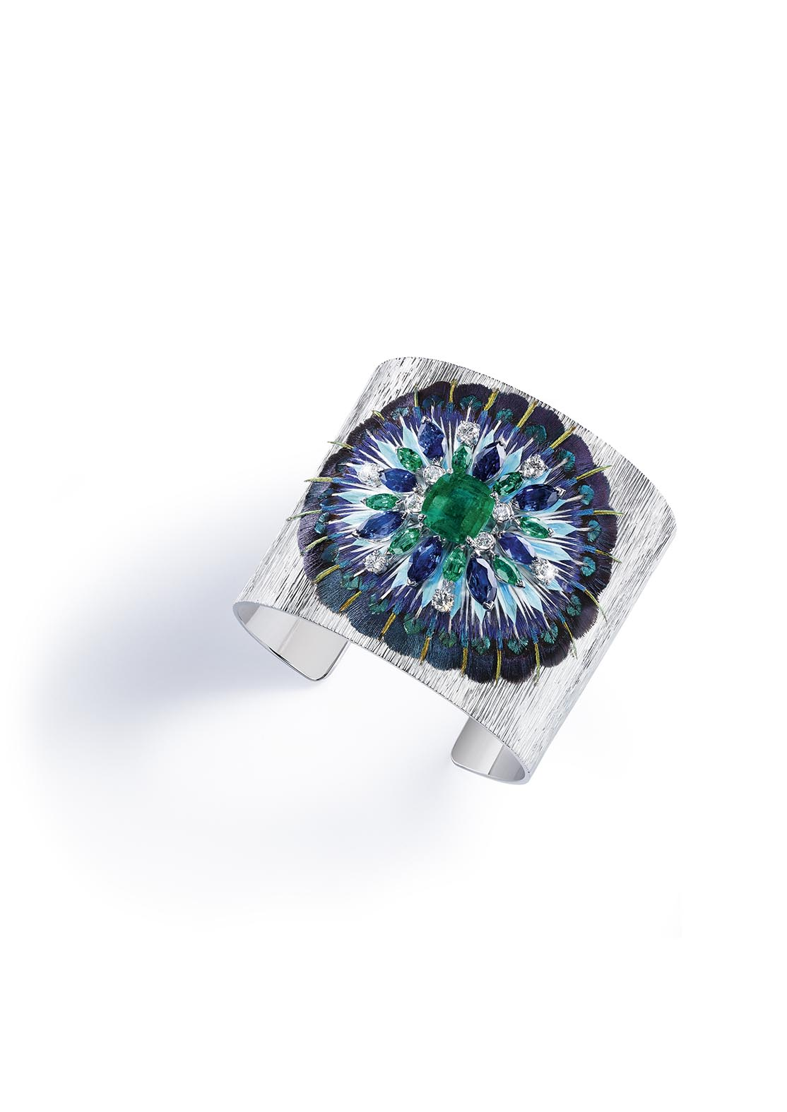 'Secrets and Lights' Piaget collection. Cuff bracelet in 18K white gold set with one cushion-cut emerald (approx. 3.46 ct), 8 marquise-cut emeralds (approx. 4.80 ct), 8 marquise-cut blue sapphires (approx. 7.66 ct), 10 brilliant-cut diamonds (approx. 1.08 ct) and feathers.