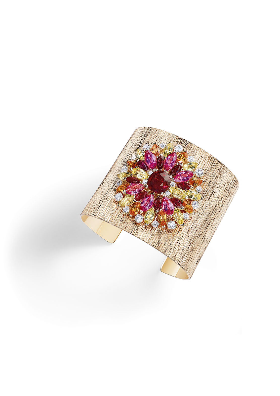 Piaget's High Jewelry Collection: Colorful Cuff Bracelet 18k pink gold set with a cushion-cut ruby, eight marquise-cut rubies, six marquise-cut pink spinels, eight marquise-cut mandarin garnets, 10 marquise-cut yellow beryls and 20 brilliant-cut diamonds.
