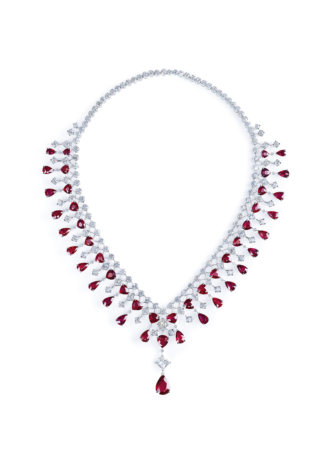Piaget's High Jewelry Collection: Ruby and Diamond Necklace. 18k white gold set with a pear shaped ruby, 45 pear-shaped rubies, a princess-cut diamond and 158 brilliant cut diamonds.
