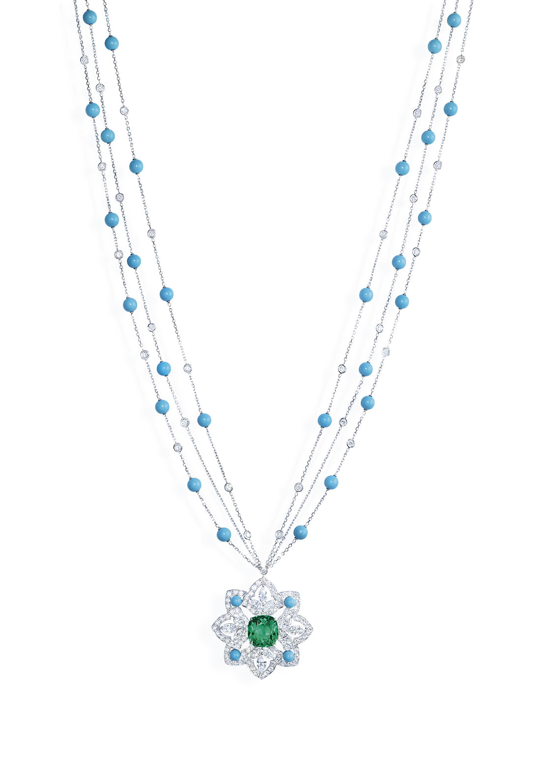 ecrets and Lights Collection by Piaget. 11.16 carat cushion cut emerald, 12 marquise cut diamonds, 151 brilliant cut diamonds, 32 turquoise beads set in 18k white gold