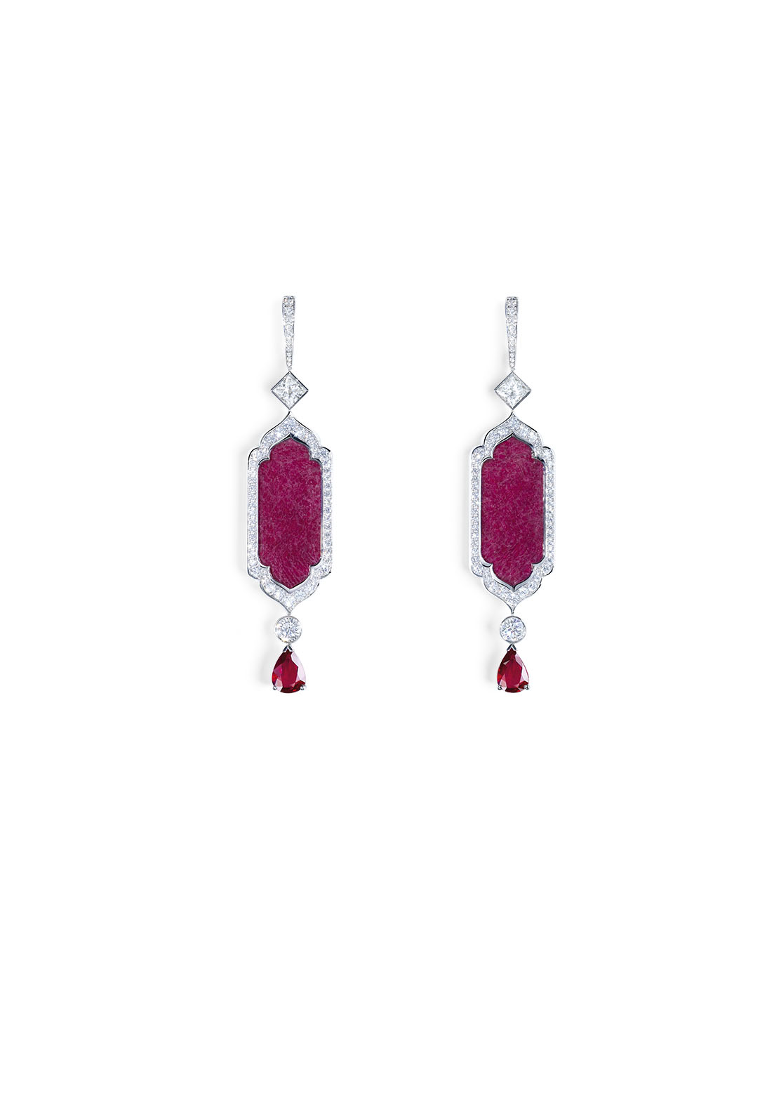 Secrets and Lights Collection by Piaget Earrings in 18K white gold set with 2 pearshaped rubies (approx. 4.13 cts), 2 fancy-cut ruby roots (approx. 12.88 cts), 2 princess-cut diamond (approx. 1.41 cts), and 120 brilliantcut diamonds (approx. 2.93 cts).