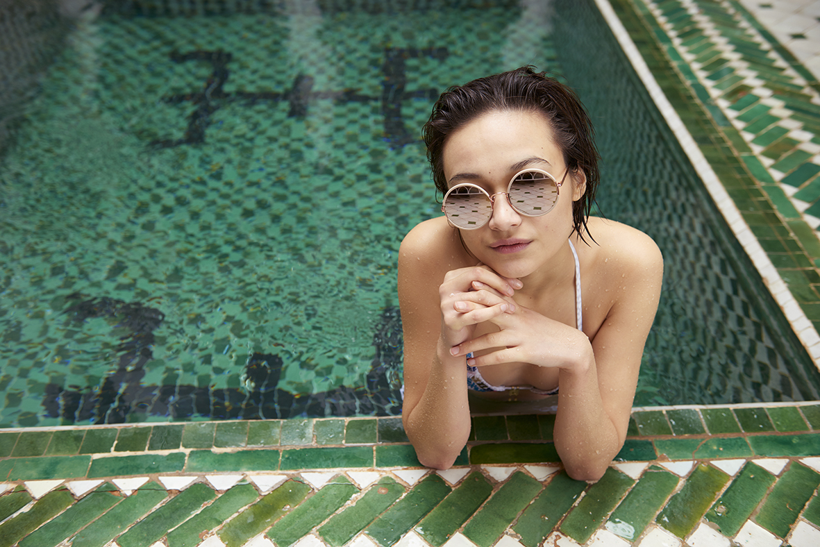 sunday somewhere sunglasses woman in swimming pool green