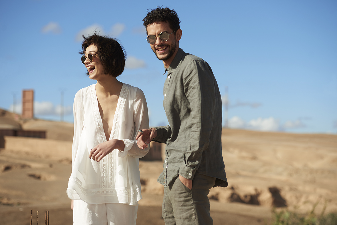 sunday somewhere man and woman in desert laughing
