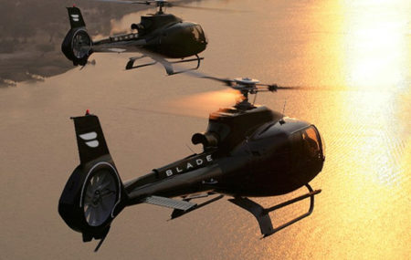blade helicopters over water sunset