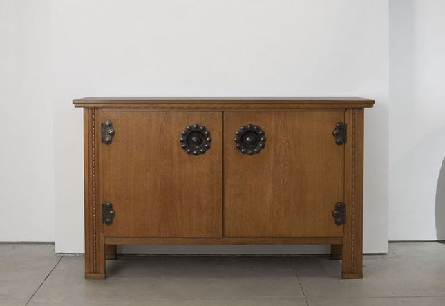 HOSTLER BURROWS: Carl Westman (Swedish, 1866 - 1936) Cabinet, ca. 1915; oak with hand-hammered iron