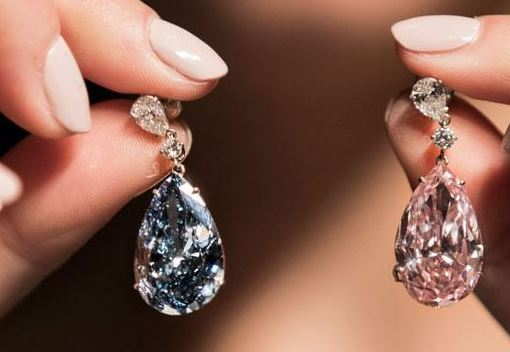 APOLLO AND ARTEMIS DIAMONDS twin fancy colored diamonds of 14.54 cts and 16 cts, respectively, sold for $57 million at Sotheby's Geneva auction in May. Photo courtesy of Sotheby's