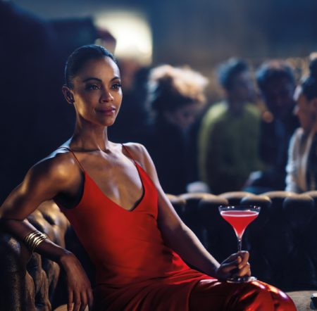 Zoe Saldana plays Mia Parc in the Campari Red Diaries Legend of Red Hand short movie, pictured wearing Fendi Red Boots and Vhernier Plissé bracelet in satin rose gold, with a Shaken Campari cocktail. Image by Matteo Bottin