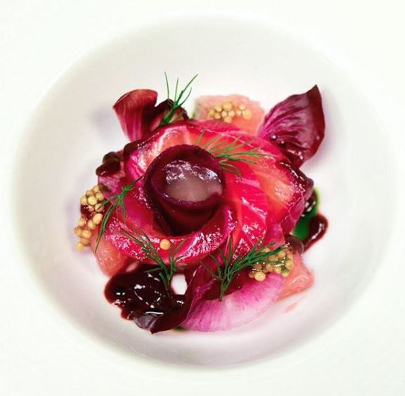 Aquavit: Beet cured Gravlax 'Rose' with watermelon radish, grapefruit, mustard seeds, endive and dill.
