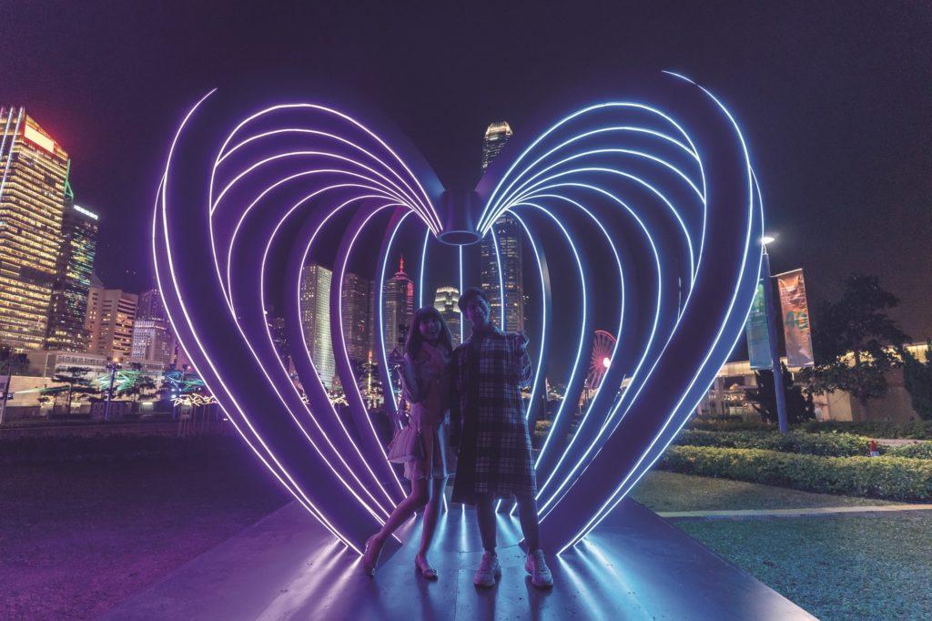 HONG KONG, HONG KONG - JANUARY 17: Models poses in front of the Capture installation at the Hong Kong Pulse Light Festival International Light Art Display on January 17, 2019 in Hong Kong, Hong Kong. (Photo by Anthony Kwan/Getty Images for Hong Kong Tourism Board)